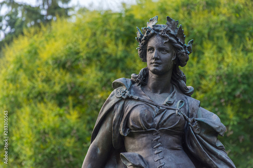 Fototapety, obrazy: Statue representing Styria in the city park Stadtpark, a green island in the middle of the city, in Graz, Styria region, Austria.