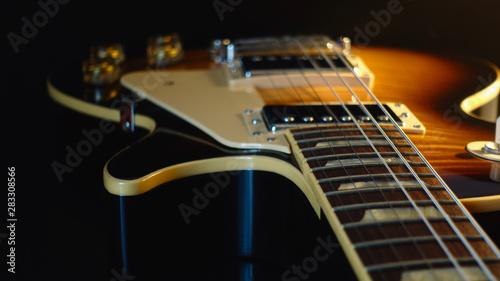 electric guitar . dark background . closeup - 283308566