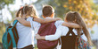 canvas print picture - school friends a boy and two girls with school backpacks on their backs walk after class