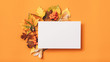 canvas print picture Autumn holiday invitation. White mockup paper sheet with foliage decoration on orange background. Copy space.