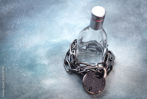 Alcoholism, alcohol addiction concept with alcohol drink bottle and chain with lock Wallpaper Mural