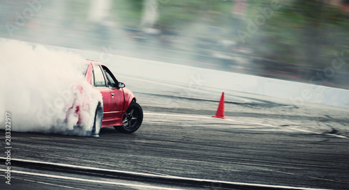 Fotografía Blurred of diffusion race drift car with lots of smoke from burning tires on speed track