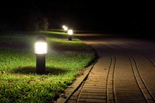 Illuminated Garden Alley In The Night