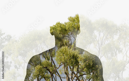 Photographie Double exposure silhouette head portrait of a thoughtful man combined with photograph of forest landscape