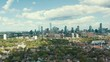 Aerial establishing shot of residential areas in a large metropolitan city. Cinematic 4K footage.