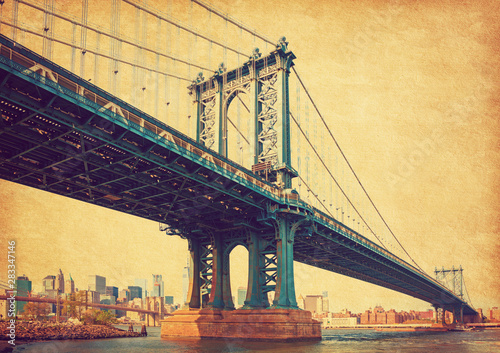 The Manhattan Bridge, New York City, United States. In the background  Manhattan and  Brooklyn Bridge. Photo in retro style. Added paper texture.