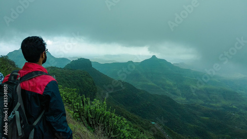 A person looking at a mountain peak Canvas Print