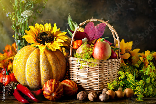 Obraz The table, decorated with vegetables and fruits. Harvest Festival. Happy Thanksgiving. Autumn background. Selective focus. - fototapety do salonu