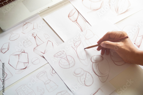 Photo  Production designer sketching Drawing Development Design product packaging proto