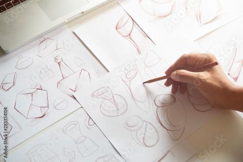 Obraz Production designer sketching Drawing Development Design product packaging prototype idea Creative Concept - fototapety do salonu