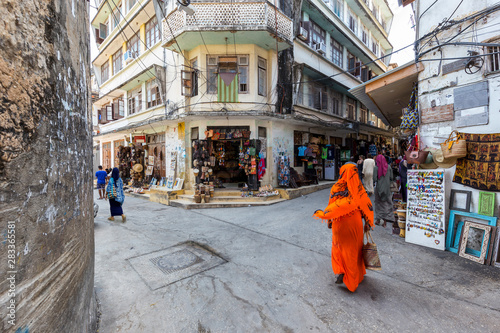 Spoed Fotobehang Zanzibar corner street scene in the city of stone town zanzibar town full of life and activity
