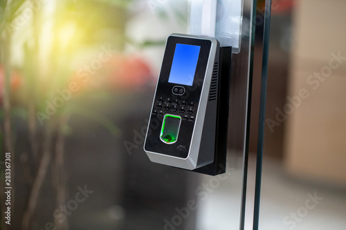 Valokuva  Facial recognition and fingerprints scanner machine for access door security and for records time attendance