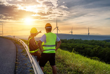 Two Engineers Consulted To Fix And Repair Wind Turbines To Generate Electricity With Natural Energy.