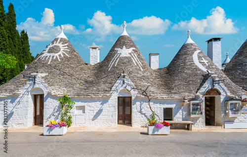 Scenic sight in Alberobello, the famous Trulli village in Puglia (Apulia), southern Italy Wallpaper Mural