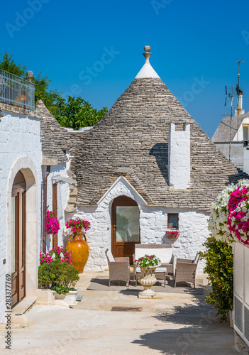 Scenic sight in Alberobello, the famous Trulli village in Puglia (Apulia), southern Italy Canvas Print
