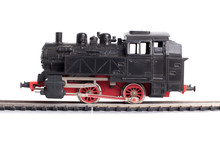 Steam Train Model On Rails On A White Background
