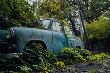 Abandoned Rusty Car In Junkyar...