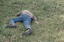 The Corpse Of A Tramp In The Grass. Criminal. Alcoholic Intoxication. Killing A Homeless Man. Dead Body After Lightning Strike