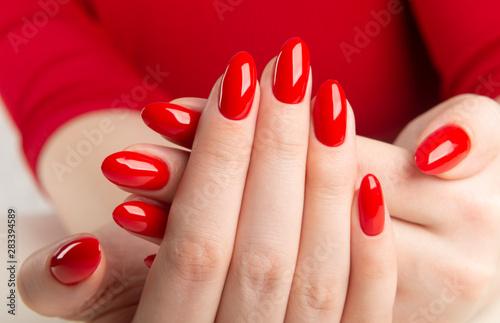 Obraz na plátně hands with red manicure.