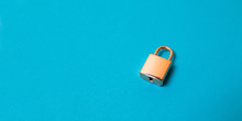 Locked Golden Padlock On The Blue Background.