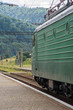 Russian electric Locomotive, train, railway station in the mountains