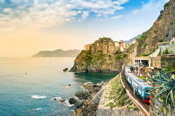 Manarola, Cinque Terre - train station in famous village with colorful houses on cliff over sea in Cinque Terre