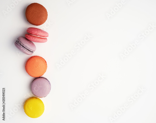 Foto auf Gartenposter Macarons stack of colorful baked macaron almond flour on a white background