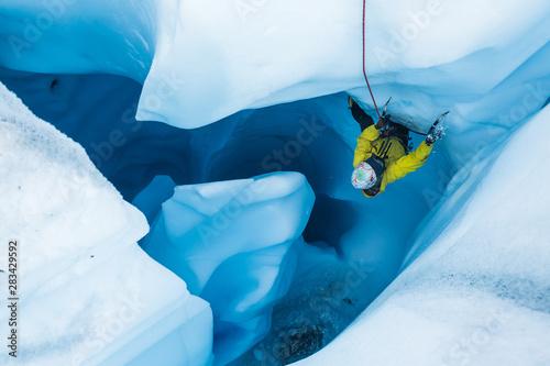 Vászonkép Climbing overhanging glacier ice in a moulin in Alaska.