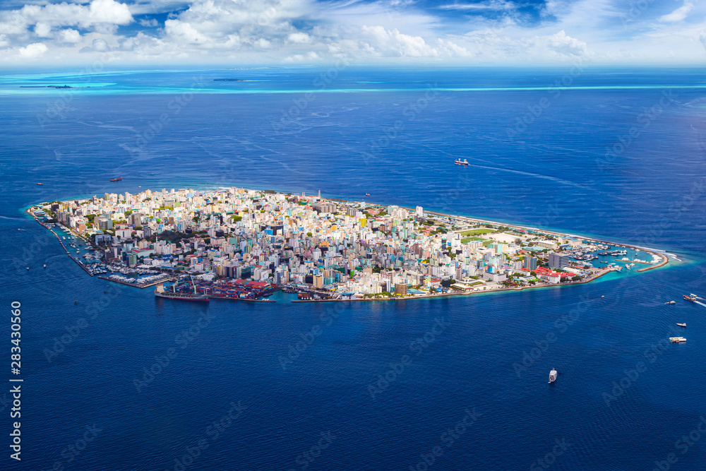 Fototapeta aerial view on male the capital city of maldives. overcrowded island in the indian ocean  blue ocean sea background