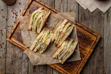 Club Sandwich With Chicken On Wooden Board