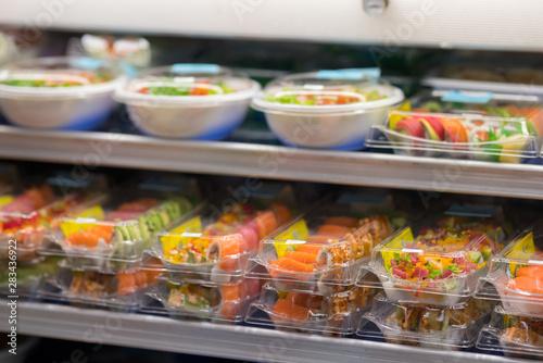 Fotografie, Obraz Fresh sushi for sale at a supermarket deli in togo containers