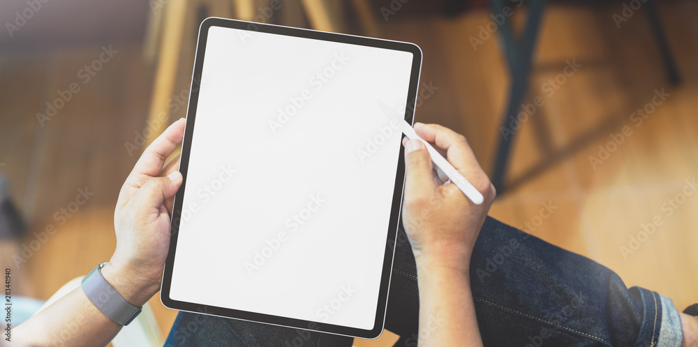 Fototapety, obrazy: Professional freelancer editing his concept with blank screen tablet