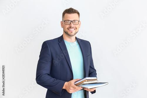 Handsome male teacher on light background Fototapeta