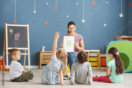Fotografie, Obraz  Cute little children learning letters in kindergarten