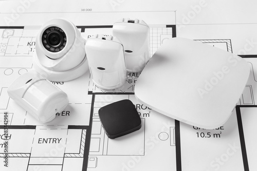 Different equipment of security system on home plan Fototapeta