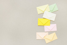 Colorful Envelopes On Grey Paper Background, Copy Space.