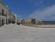 Otranto panorama of the beach and of the southern promenade. Otranto sandy beach and its white southern promenade are located on the Adriatic coast of Salento, Italy.