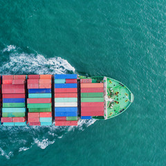 Aerial view container ship to sea port loading container for import export or transportation. shipping  business logistic. Trade Port and Shipping cargo to harbor, International transportation.