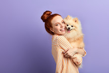 Beautiful Girl Cannot Imagine Her Life Without Her Pet. Close Up Portrait, Isolated Blue Background, Studio Shot
