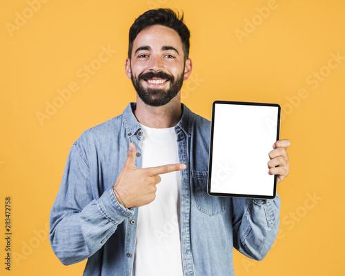 Medium shot guy pointing at a tablet Canvas Print