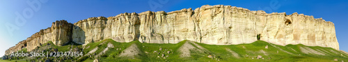 Fotografie, Obraz Wide panorama of precipitous edge of limestone plateau against sky