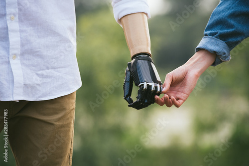 CloseUp Shot Of Man With a prosthetic limb Holding Hands With Female Partner Fototapeta