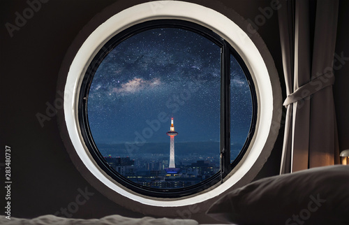 Looking through window, Kyoto city view with starry sky at night in Japan Fototapeta