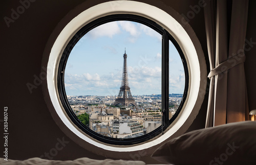 Looking through window, Eiffel tower famous landmark in Paris, France. Vacation in Europe