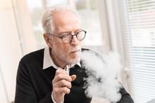 Senior Man Smoking Electronic Cigarette