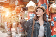 Smiling Woman Traveler In Chiangmai Market Landmark Chiangmai Thailand Holding Smartphone With Backpack On Holiday, Relaxation Concept, Travel Concept