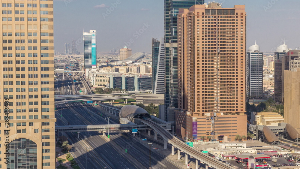 Skyline internet city with crossing Sheikh Zayed Road aerial timelapse