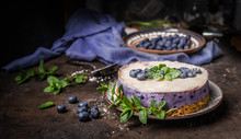 Vegan Blueberry Cake On Dark Rustic Kitchen Table Background With Fresh Berries, Side View. Healthy Food
