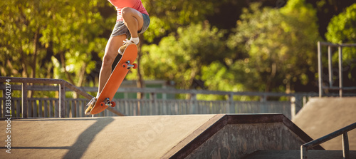 Skateboarder skateboarding on skatepark ramp Canvas