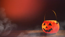 Halloween Concept - Orange Plastic Pumpkin Lantern On A Dark Wooden Table With Blurry Sparkling Light In The Background, Trick Or Treat, Close Up.